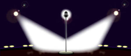spot lit: A microphone spot lit by two spotlights on a wide stage
