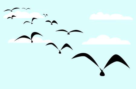 Een zwerm zwarte vogels instellen tegen een blauwe hemel