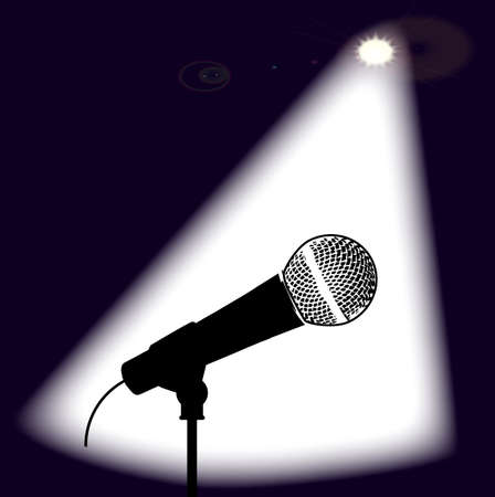 spotlit: A microphone ready on stage for the performer