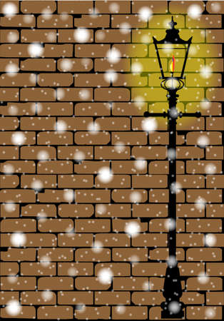 A typical old London gaslight set against a worn brick wall with shadow against a snowfall