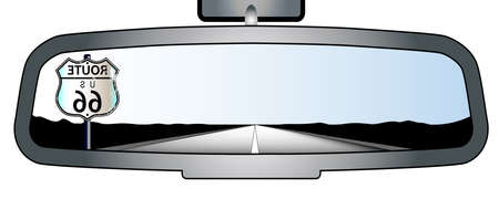rear view mirror: Depiction of a vehicle rear view mirror showing a reflected route 66 sign