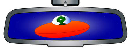 flying saucer: A vehicle rear view mirror showing an alien in his flying saucer