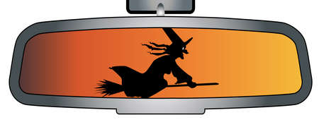 A vehicle rear view mirror showing an halloween witch on her broomstick