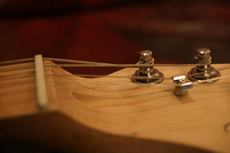 Closeup view of a set of electric guitar tuning pegs