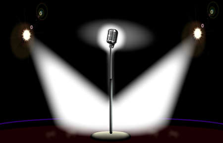 spotlit: A microphone spot lit by two spotlights on stage.
