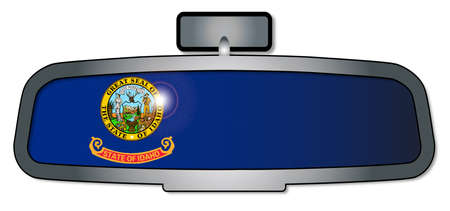rear view mirror: A vehicle rear view mirror with the flag of the state of Idaho
