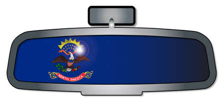 rear view mirror: A vehicle rear view mirror with the flag of the state of North Dakota