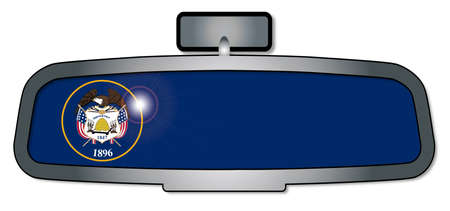 rear view mirror: A vehicle rear view mirror with the flag of the state of Utah