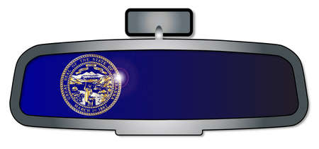 rear view mirror: A vehicle rear view mirror with the flag of the state of Nebraska