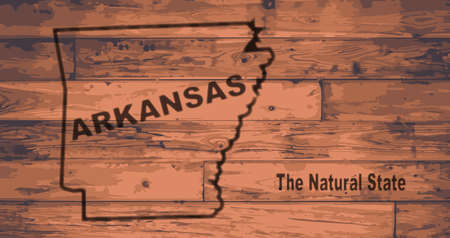 Arkansas state map brand on wooden boards with map outline and state moto
