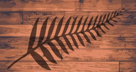 onto: New Zealand fern brandeded onto wooden planks
