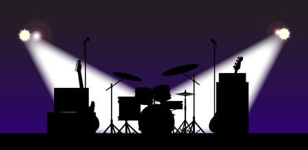 spotlit: Silhouette of a rock bands equipment on stage under spotlights