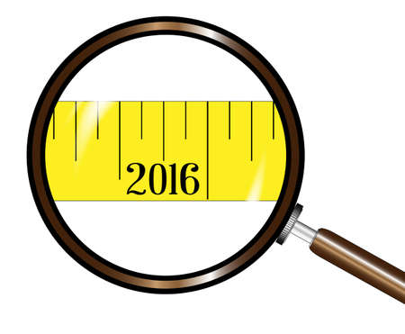 watch new year: A magnifying glass showing the year 2016 on a tape measure