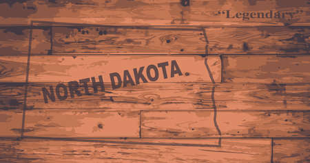 motto: North Dakota state map brand on wooden boards with map outline and state motto