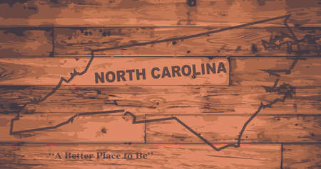 motto: North Carolina state map brand on wooden boards with map outline and state motto