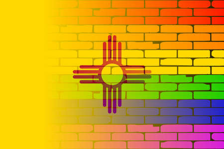 new mexico: A well worn wall painted with a LGBT rainbow with the New Mexico state flag