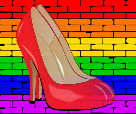 stiletto: A well worn wall painted with the LGBT rainbow against a pair of stiletto heel shoes