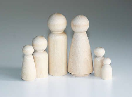 peg: A family of wooden peg people gathered together