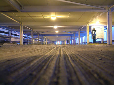 floor level: A parking lot devoid of any vehicles yaken from floor level