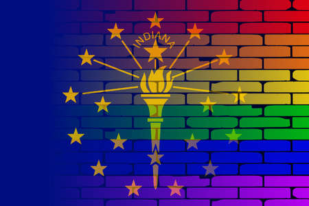 transsexual: A well worn wall painted with a LGBT rainbow with the Indiana state flag