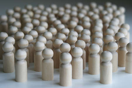 turned: A group of wooden turned part people gathered together