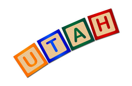 block letters: A collection of wooden block letters spelling Utah over a white background