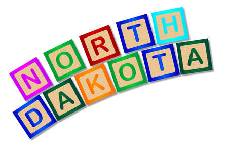 block letters: A collection of wooden block letters spelling North Dakota over a white background