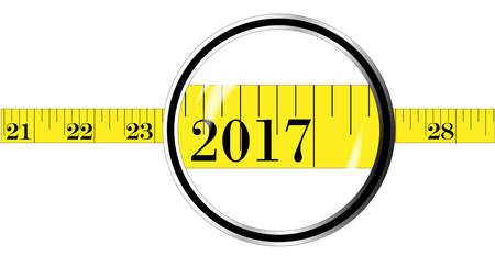 watch new year: A magnifying glass over a tape measure with the date 2017