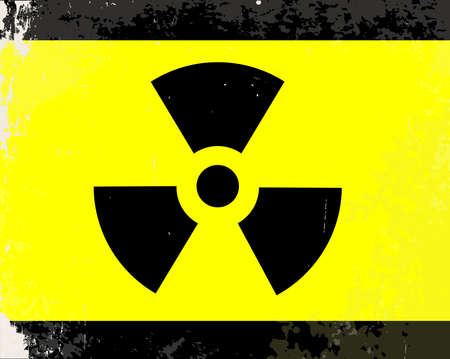 hazardous material: A worn Caution Radiation symbol in yellow and black