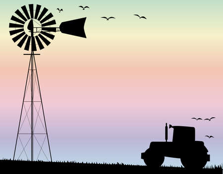 A small water pump windmill and a farm tractor silhouetted by sky
