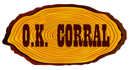 A section of a log with the words OK Corral over a white background