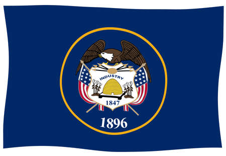 The flag of the American state of Utah waving in the wind