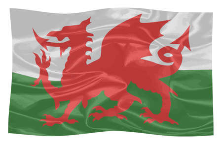 A cloth national dragon flag of Wales fluttering in the wind