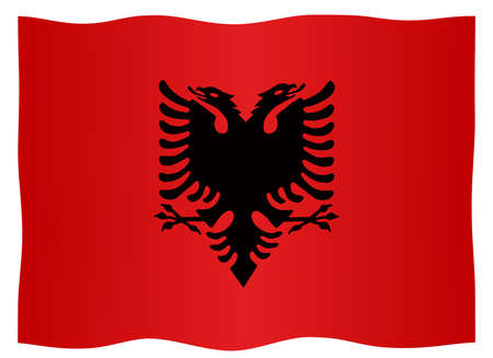 The flag of Albania with national emblem fluttering on a white background