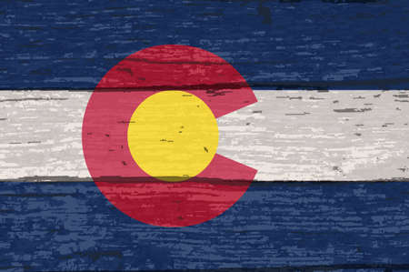The flag of the USA state of Colorado on am old wooden background