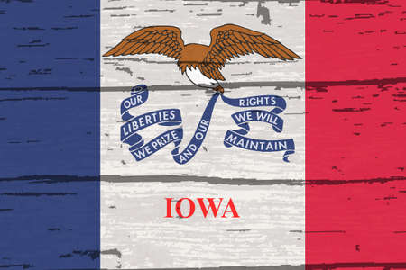 The flag of the USA state of Iowa on a wooden background