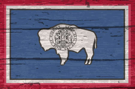 The flag of the USA state of Wyoming on a wooden background 写真素材