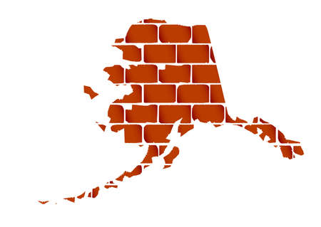 A section of brick wall as a background to the outline map of the state of Alaska Illustration