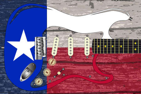 The flag of the USA state of TEXAS on old timber with a traditional electric guitar