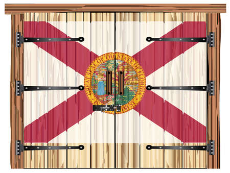 A large closed wooden barn double door with bolt and hinges and the Florida flag painted on Banco de Imagens - 115445029
