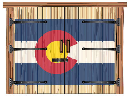 A large closed wooden barn double door with bolt and hinges and the Colorado flag painted on
