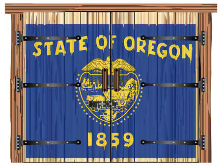 A large closed wooden barn double door with bolt and hinges and the Oregon flag painted on Banco de Imagens - 115445042