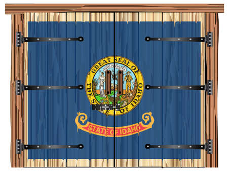 A large closed wooden barn double door with bolt and hinges and the Idaho flag painted on