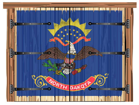 A large closed wooden barn double door with bolt and hinges and the North Dakota state flag painted on
