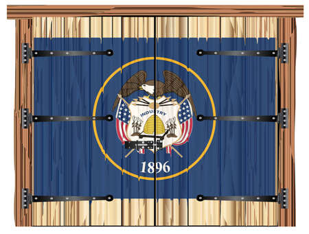 A large closed wooden barn double door with bolt and hinges and the Utah state flag painted on