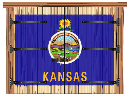 A large closed wooden barn double door with bolt and hinges and the Kansas state flag painted on