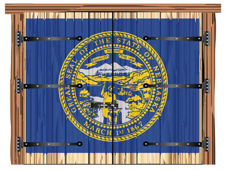 A large closed wooden barn double door with bolt and hinges and the Nebraska state flag painted on Banco de Imagens - 115445051