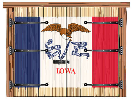 A large closed wooden barn double door with bolt and hinges and the Iowa state flag painted on