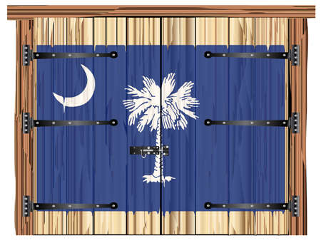 A large closed wooden barn double door with bolt and hinges and the South Carolina state flag painted on