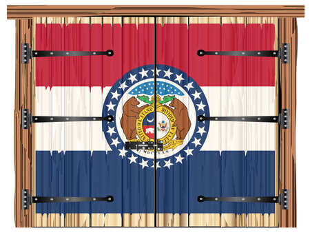 A large closed wooden barn double door with bolt and hinges and the Missouri state flag painted on